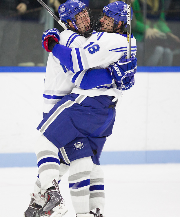 Jack Burton and Mario Benicky, of Colby College, in a NCAA Division III hockey game against Bowdoin College on November 22, 2014 in Waterville, ME. (Dustin Satloff/Colby College Athletics)