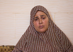 © Licensed to London News Pictures. 17/07/2014. Gaza.   <br /> The mother of Ismail Bakir, Sahi Bakir one of the four boys killed in an Israeli air strike on a beach in Gaza sits in his house and received condolences from surrounding families.  Photo credit: Alison Baskerville/LNP