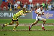 England's Will Edwards makes a break past Australia's Tom Kingston during the HSBC World Rugby Sevens Series - Singapore, Bronze match Australia-V-England at The National Stadium, Singapore on Sunday, April 16, 2017. (Steve Flynn/Image of Sport)