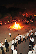 Israel, Haifa, Neve Shaanan, Jews dance around the bonfire during the lag b'omer celebrations. Lag B'Omer is a day for bonfire celebrations.