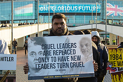 "As a small group of Sikh  protesters demonstrate outside Wembley Stadium, thousands of the UK's Indian community stream into the stadium ahead of an address to more than 60,000 by Indian Prime Minister Narendra Modi at a 'UK Welcomes Modi' reception. With more than 9 billion worth of trade deals signed during his visit, the euphoria is tempered by the fact that just a few years ago he was a persona non grata in the UK. Modi, a Hindu and his BJP party are accused of a wide range of human rights abuses against religious and ethnic minorities in India. PICTURED: A Sikh protester with his banner contrasts with the ""One Glorious Future"" sign in the background. ©2015 Paul Davey. All rights reserved.   // Licensing: Please contact Paul Davey paul@pauldaveycreative.co.uk Tel +44 (0) 7966 016 296 or +44 (0) 208 969 6875."