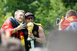 15.07.2014, Brandenburger Tor, Berlin, GER, FIFA WM, Empfang der Weltmeister in Deutschland, Finale, im Bild Bastian Schweinsteiger (GER) li. und Lukas Podolski (GER) re. mit dem FIFA-WM-Pokal. Rechts Kevin Grosskreutz (GER), // during Celebration of Team Germany for Champion of the FIFA Worldcup Brazil 2014 at the Brandenburger Tor in Berlin, Germany on 2014/07/15. EXPA Pictures © 2014, PhotoCredit: EXPA/ Eibner-Pressefoto/ Harzer<br /> <br /> *****ATTENTION - OUT of GER*****