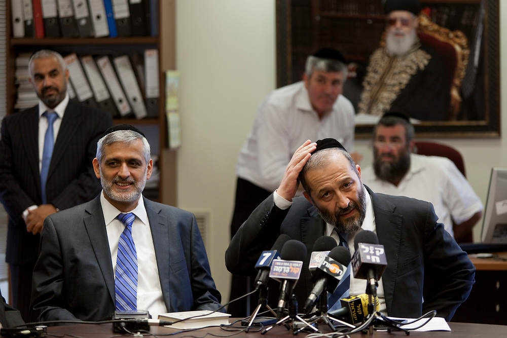 Leader of the ultra-Orthodox Jewish Shas party Aryeh Deri (R) and Shas party parliament member Eli Yishai (2nd L) attend a Shas faction meeting at the Knesset, Israel's parliament in Jerusalem, on June 17, 2013.