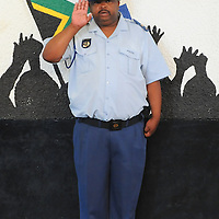 KHAYELITSHA, SOUTH AFRICA - Monday 9 December 2013, the City of Cape Town hosted an Evening of Remembrance at the OR Tambo hall, Khayelitsha. for the late former President of South Africa, Nelson Mandela. A police officer salutes during the playing of the national anthem.<br /> Photo by Roger Sedres/ImageSA
