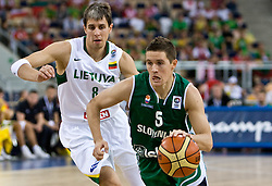 Mindaugas Lukauskis of Lithuania vs Jaka Lakovic (5) of Slovenia during the EuroBasket 2009 Group F match between Slovenia and Lithuania, on September 12, 2009 in Arena Lodz, Hala Sportowa, Lodz, Poland.  (Photo by Vid Ponikvar / Sportida)