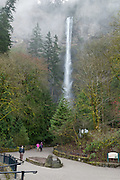 Multnomah Falls plunges 620 feet in two tiers in Columbia River Gorge National Scenic Area, adjacent to Interstate 84 and Historic Columbia River Highway, in Oregon, USA.