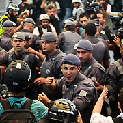 Anti-World Cup protesters clash with police in a train station on the first day of the World Cup in Sao Paulo on Thursday, June 12, 2014. The protests disrupted traffic at the station. Credit: Byron Smith