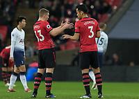 Football - 2018 / 2019 Premier League - Tottenham Hotspur vs. Southampton <br /> <br /> Matt Targett (Southampton FC ) and Maya Yoshida (Southampton FC ) discuss what happened after conceding an early goal at Wembley Stadium.<br /> <br /> COLORSPORT/DANIEL BEARHAM