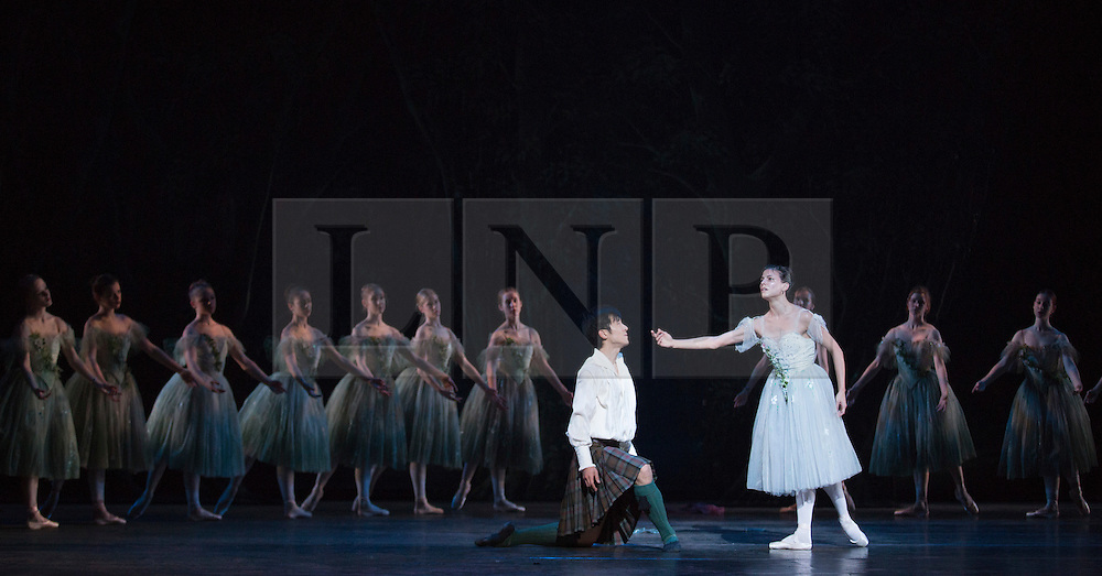 © Licensed to London News Pictures. 04/08/2015. London, UK. Qi Huan as James and Yanela Pinera as The Sylphide. Dress rehearsal of La Sylphide (some parts in partial costume). Australia's Queensland Ballet makes its London Coliseum debut with La Sylphide, the August Bournonville ballet is choreographed by Peter Schaufuss. Performances at the Coliseum from 5 to 8 August 2015. Photo credit: Bettina Strenske/LNP