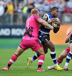 Semesa Rokoduguni of Bath Rugby is tackled - Photo mandatory by-line: Patrick Khachfe/JMP - Mobile: 07966 386802 13/09/2014 - SPORT - RUGBY UNION - Bath - The Recreation Ground - Bath Rugby v London Welsh - Aviva Premiership