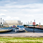 Traffic rushes over the Arlington Memorial Bridge over the Potomac in the evening rush hour as commuters leave work from Washington DC. The Lincoln Memorial is in the background.