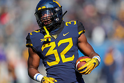 Nov 10, 2018; Morgantown, WV, USA; West Virginia Mountaineers running back Martell Pettaway (32) warms up before their game against the TCU Horned Frogs at Mountaineer Field at Milan Puskar Stadium. Mandatory Credit: Ben Queen-USA TODAY Sports