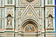 The right door mosaic and the fine Gothic architectural detail  of  the  of the Gothic-Renaissance Duomo of Florence,  Basilica of Saint Mary of the Flower; Firenza ( Basilica di Santa Maria del Fiore ).  Built between 1293 & 1436. Italy .<br /> <br /> Visit our ITALY PHOTO COLLECTION for more   photos of Italy to download or buy as prints https://funkystock.photoshelter.com/gallery-collection/2b-Pictures-Images-of-Italy-Photos-of-Italian-Historic-Landmark-Sites/C0000qxA2zGFjd_k<br /> .<br /> <br /> Visit our MEDIEVAL PHOTO COLLECTIONS for more   photos  to download or buy as prints https://funkystock.photoshelter.com/gallery-collection/Medieval-Middle-Ages-Historic-Places-Arcaeological-Sites-Pictures-Images-of/C0000B5ZA54_WD0s