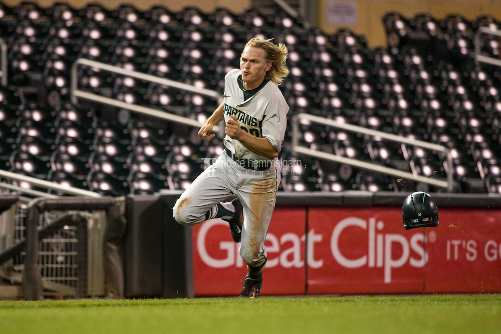 Cam Gibson (30) of the Michigan State Spartans runs during a 2015 Big Ten Conference Tournament game between the Maryland Terrapins and Michigan State Spartans at Target Field on May 20, 2015 in Minneapolis, Minnesota. (Brace Hemmelgarn)