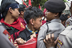 September 4, 2017 - Central Jakarta, Indonesia - Students and Police push each other as the student try to break police barricade. National Amanah Party (PAN) youth generation and Students of Islam Unity afterward held demonstration in front of Myanmar Embassy demanding the stop of killing and slaughtering Rohingya People at Myanmar. (Credit Image: © Donal Husni via ZUMA Wire)