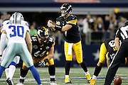 Pittsburgh Steelers quarterback Ben Roethlisberger (7) makes a squeeze gesture to his teammates at the line of scrimmage at Cowboys Stadium in Arlington, Texas, on December 16, 2012.  (Stan Olszewski/The Dallas Morning News)