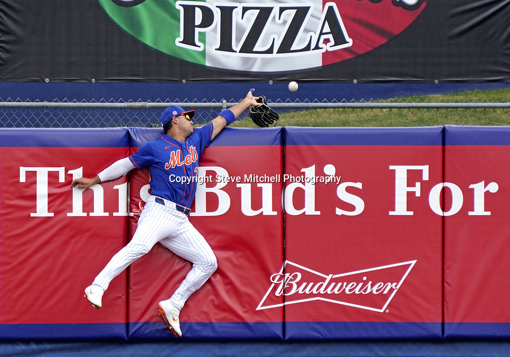 Mar 3, 2020; Port St. Lucie, Florida, USA; New York Mets right fielder Michael Conforto (30) losses his glove on attempting to catch a home run from Miami Marlins right fielder Garrett Cooper (not pictured) at Clover Park. Mandatory Credit: Steve Mitchell