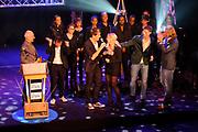 Radio Ring Gala 2012 in hetTheater Gooiland, Hilversum.<br /> <br /> Op de foto:  Gerard Ekdom de Gouden Radioring 2012 uit handen van Frits Spits