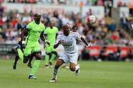 Andre Ayew of Swansea city ® in action.Barclays Premier league match, Swansea city v Manchester city at the Liberty Stadium in Swansea, South Wales on Sunday 15th May 2016.<br /> pic by Andrew Orchard, Andrew Orchard sports photography.
