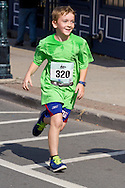 Middletown, New York - Michael Fitzpartick of New Hampton heads for the finish line in the Orange Regional Medical Center's Run 4 Downtown road race on Aug. 16, 2014. All the proceeds from the Run 4 Downtown go to revitalizing Middletown's Historic district.