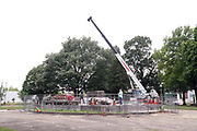 Workmen remove a pedestal that once held a statue of Confederate general and early member of the Ku Klux Klan (KKK), Nathan Bedford Forrest. The statue, that was removed after protests in December 2017, stands over his grave in Health Sciences Park in Memphis, Tennessee, U.S. June 1, 2021. The remains of Forrest and his wife below the base will be moved to Columbia, Tennessee.