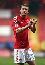 Charlton Athletic's Jason Pearce applauds the fans after the final whistle