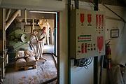 Oudenaarde, Belgium, 20 june 2017, Inside view of a working man at the Mills of Oudenaarde along the river Scheldt