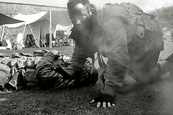 "Members of the US 82nd Airborne/505th RCT living History Group take part in the first days battle re-enactment at Fort Paull one reenactor beside a ""battlefield casualty"" he has just dragged out of the line of fire<br /> <br />   03 May 2015<br />   Image © Paul David Drabble <br />   www.pauldaviddrabble.co.uk"