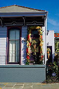 Christmas decorations hang on a purple house in the French District in New Orleans, Louisiana.
