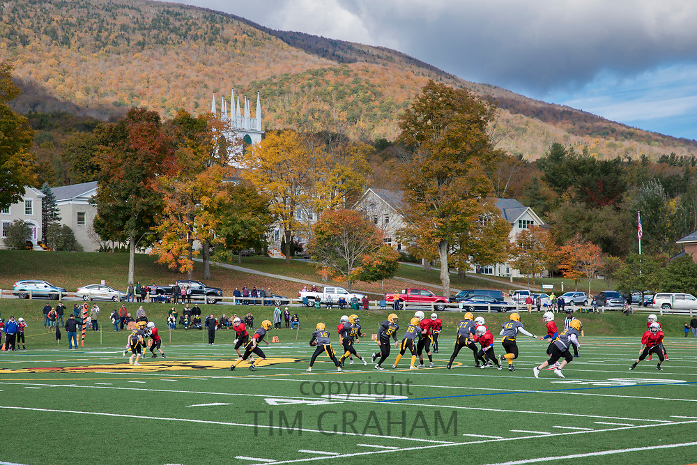 Youngsters boys and young men playing America football match game on school playing field in Manchester, Vermont, USA