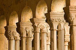 Europe, Croatia, Dalmatia, Dubrovnik.  Franciscan Monastery (built 1317 and rebuilt 1667), with stone arches surrounding courtyard of late Romanesque cloister. The historic center of Dubrovnik is a UNESCO World Heritage site.