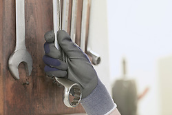 Close-up of engineer hand holding a spanner in an industrial plant, Freiburg im Breisgau, Baden-W¸rttemberg, Germany