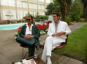 """Sade and Tony Hadley Interviews.  P92..1984.21.08.1984..08.21.1984..21st August 1984..As part of his interview sessions for """"Video File"""" for R.T.E., Marty Whelan interviewed international music stars. The interviews were held in the R.T.E.,studios and at various hotels throughout the city...Gary Kemp and Tony Hadley are pictured in the gardens of Jury's Hotel in Ballsbridge during  their interview with Marty Whelan."""
