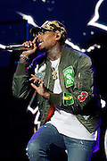 """Chris Brown performs during his """"One Hell of a Nite"""" Tour at the Sprint Center on Wednesday, Aug. 12, 2015, in Kansas City, MO. (Photo by Colin E. Braley/Invision/AP)"""