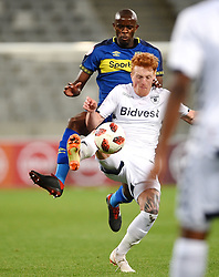 Cape Town-181002- Cape Town City defender Kwanda Mngonyama challenges Simon Simon Murray  of Bidvest Wits in a PSL clash at Cape Town Stadium.Cape town City come to this game with high confidence after winning the MTN 8 cup over the weekend,while Wits will be fighting for the the top spot they have lost after some poor display in their last two games.Photographs:Phando Jikelo/African News Agency/ANA
