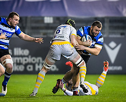 Will Stuart of Bath Rugby is tackled by James Gaskell and Dan Robson of Wasps - Mandatory by-line: Andy Watts/JMP - 08/01/2021 - RUGBY - Recreation Ground - Bath, England - Bath Rugby v Wasps - Gallagher Premiership Rugby