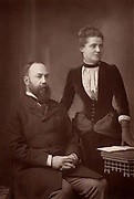 Charles Wentworth Dilke, second Baronet (1843-1911) English politician and author.  His political career was blocked because he was a co-respondent in a divorce suit (1885-1886). Emilia Frances Strong Dilke (1840-1904), historian of French art, married Dilke in 1885.    From 'The Cabinet Portrait Gallery' (London, 1890-1894).  Woodburytype after photograph by W & D Downey.