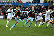 Andre Gray of Burnley scores his teams 1st goal from a penalty to make it 1-1. Premier league match, Swansea city v Burnley at the Liberty Stadium in Swansea, South Wales on Saturday 4th March 2017.<br /> pic by Andrew Orchard, Andrew Orchard sports photography.