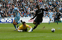 Photo: Steve Bond/Richard Lane Photography.<br /> Coventry City v Chelsea. FA Cup 6th Round. 07/03/2009. Didier Drogba (R) rounds keeper Keiren Westwood before scoring