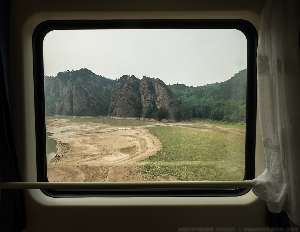 The landscape approaching Tianshui. Window view across China, from Hong Kong to Urumqi, Xinjiang.