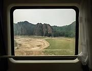 The landscape approaching Tianshui. Window view across China, from Hong Kong to Urumqi, Xinjiang.