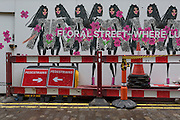 A retailer's construction hoarding and street barriers and signs near Covent Garden, on 28th February 2017, in London, England.