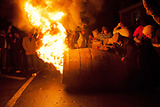 The final barrel of the night is prepared for the mens running. The annual running of the tar barrels in Ottery St Mary, Devon is a tradition thought to go back as far as 500 years. Every November the 5th, crowds of thousands flock to this small town in the south west of England to see men, women and children run with burning barrels on their shoulders. Only people who were born in Ottery are allowed to participate, and they are proud of the tradition and work hard to keep it alive, even in the face of health and safety regulations. It is not competitive but rather a supportive act where they pass the barrels between themselves, encouraging everyone in the team to have a go.