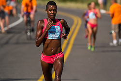 Diane Nukuri maintains hard pace near mid-point as she leads line-to-line to win