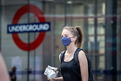 Licensed to London News Pictures. 19/07/2021. London, UK. Commuters arrive at Victoria Station, London as Covid-19 restrictions are lifted today in what is being called Freedom Day'. Today, the government has lifted Covid-19 restrictions including the 'Work from Home' advice and the enforce of wearing face masks in indoor spaces. However, Mayor of London Sadiq Khan has called on TFL to keep masks compulsory on London's public transport system after restrictions are lifted today. Photo credit: Alex Lentati/LNP