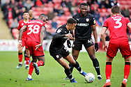 Goalscorer Barnsley forward Jacob Brown (33) is heavily marked during the EFL Sky Bet League 1 match between Walsall and Barnsley at the Banks's Stadium, Walsall, England on 23 March 2019.