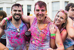 London, August 28th 2016. Friends covered in coloured powder pose for the camera as Europe's biggest street party, the Notting Hill Carnival gets underway.