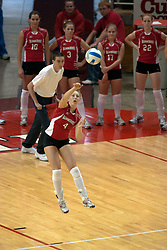 09 OCT 2005  Redbird Erin Lindsey sends an arrow the way of the Braves. The Illinois State University Redbirds hosted arch rival Bradley University Braves.  The Redbirds soared over the Braves, taking the match in 4 games, losing only game number 2.  Action included play by Braves Star Lindsey Stalzer who is ranked no. 7 in the nation in kills per game.  The first defeat of the conference season for the Braves took place at Redbird Arena on Illinois State's campus in Normal IL.