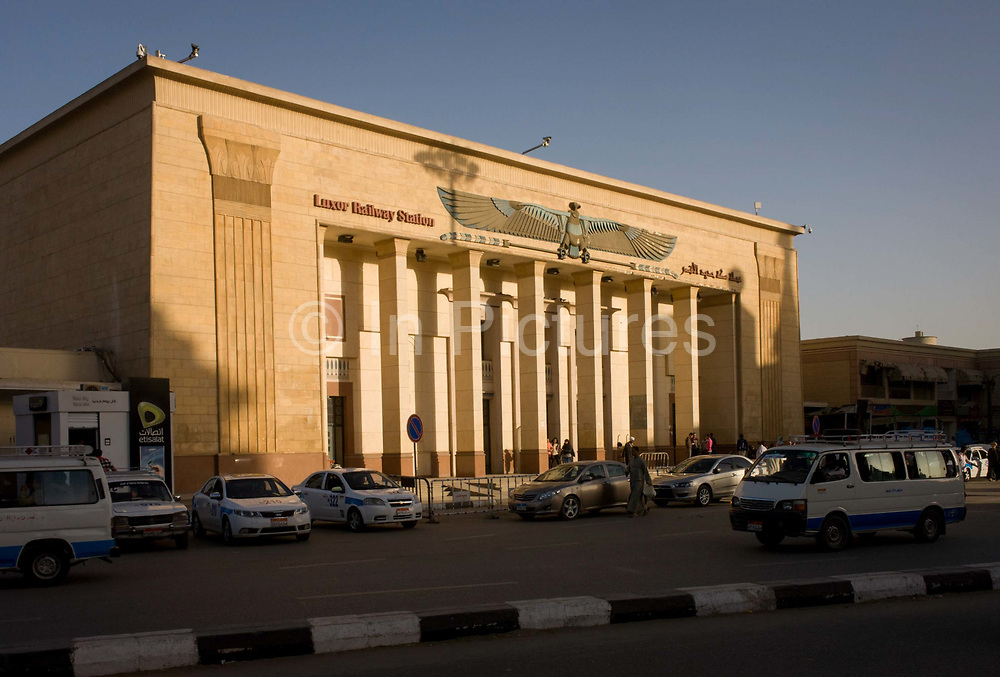 The exterior of the main railway station in modern Luxor, Nile Valley, Egypt. Overnight trains from Cairo arrive early morning with the station is some 400m from the River Nile and the ancient Egyptian antiquities of Luxor Temple.