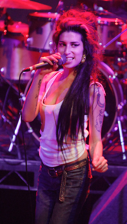 Singer Amy Winehouse, DOB=14/09/1983, performing for her gay fans at the G-A-Y Club. G-A-Y is London's biggest gay club and is held at the London Astoria nightclub, Soho, London, UK. Amy spent much of the show rubbing her itchy nose. She also seemed to have signs of old scars all down one arm...Picture Data:.Photographer: Edward Hirst.Copyright: ©2007 Licensed to Equinox News Pictures +448700 780000.Contact: Equinox Features.Date Taken: 20070415.Time Taken: 020331+0000.www.newspics.com